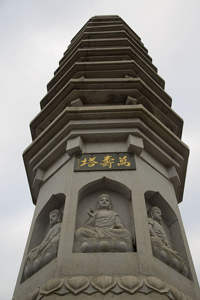 Looking up a stone pagoda in front of the Nanputuo temple complex | Nanputuo temple | China