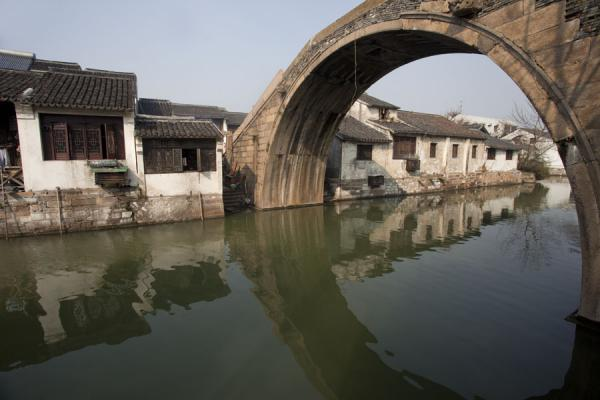 Foto van Old stone arch bridge connecting two sides of a canal in the old town of Nanxun - China - Azië