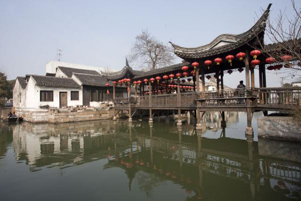 Picture of Old wooden bridge with lampoons connecting two sides of a canal in Nanxun - China - Asia