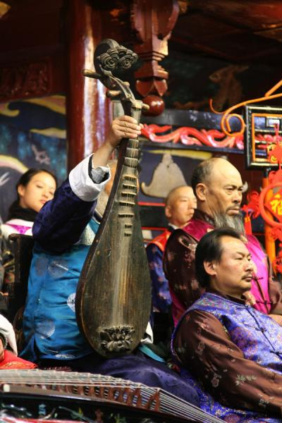 Showing ancient instrument to the audience | Naxi Orchestra | China