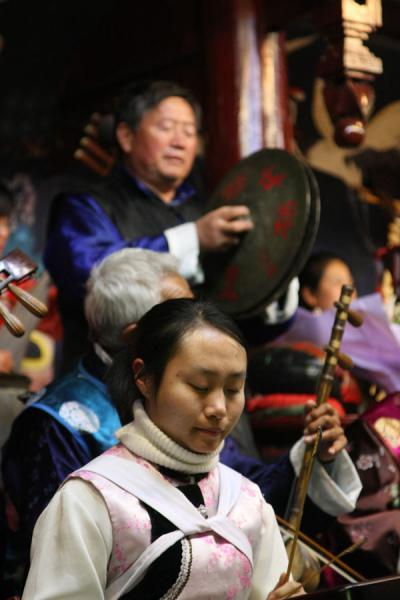 Some of the players of the Naxi Orchestra |  | 中国