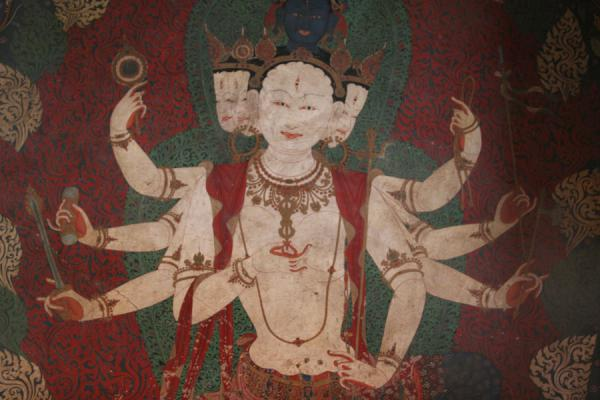 Eight-handed deity depicted on mural in Gyantse Kumbum | Pelkor Chöde monastery | China