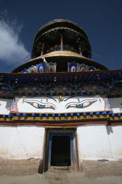 Top of Gyantse Kumbum with the remarkable eyes above the door | Pelkor Chöde monastery | China