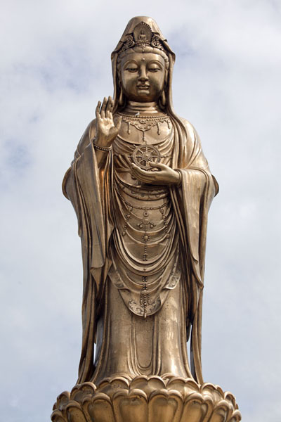 Frontal view of the golden statue of Guanyin near the south tip of Putuoshan | Putuoshan | China