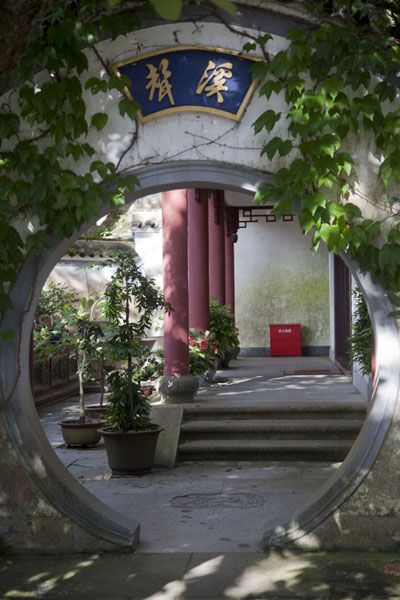 Picture of Putuoshan (China): Looking through a circular entrance into a courtyard of Puji temple complex