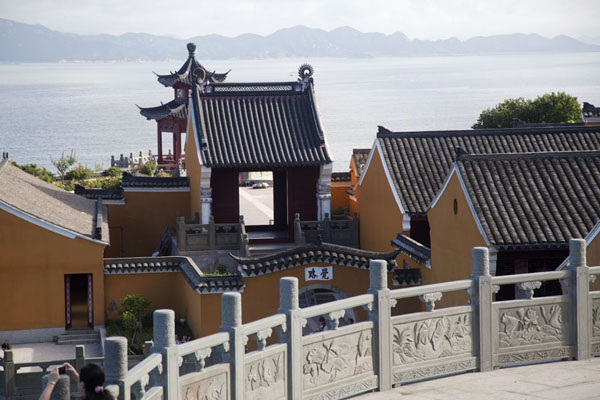 Picture of Fanyin monastery with islands in the backgroundPutuoshan - China