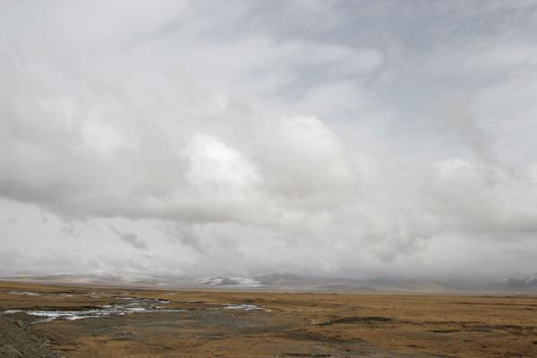 Picture of Grey clouds racing over a typical desolate landscape of Qinghai province