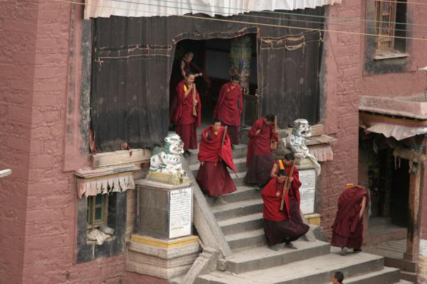Picture of Sakya monastery (China): Monks coming out of one of the hall of Sakya monastery