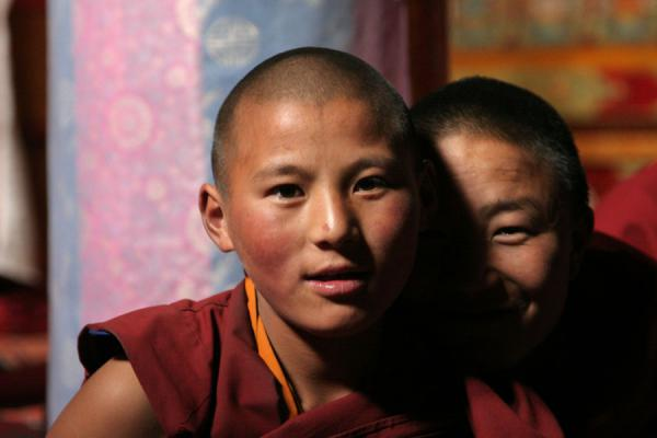 Picture of Sakya monastery (China): Two young monks posing for the camera in Sakya monastery