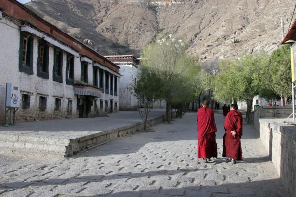 Picture of Monks entering Sera monastery in the late afternoon