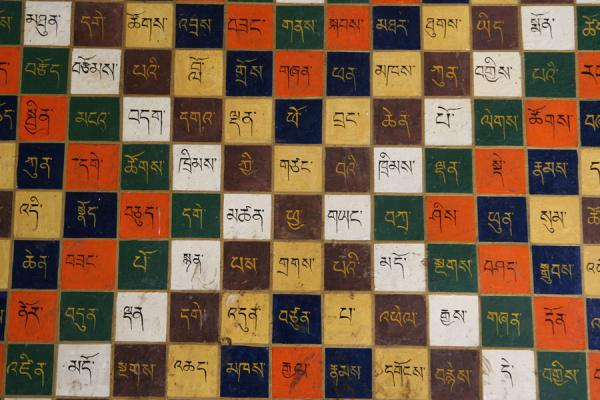Picture of Tibetan calendar with elegant Tibetan characters painted on wall of Sera monastery
