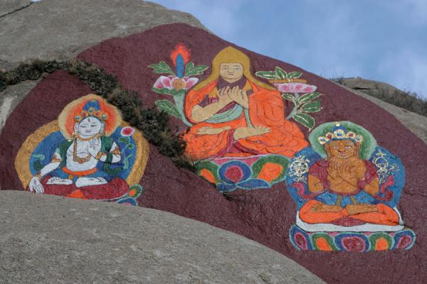 Picture of Sera monastery (China): Colourful religious rock paintings above Sera monastery
