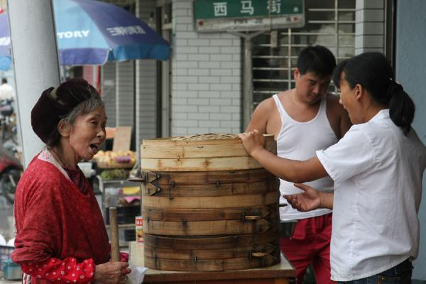 Old Chinese woman in traditional clothes at a food stall | Shanghai Old City | China