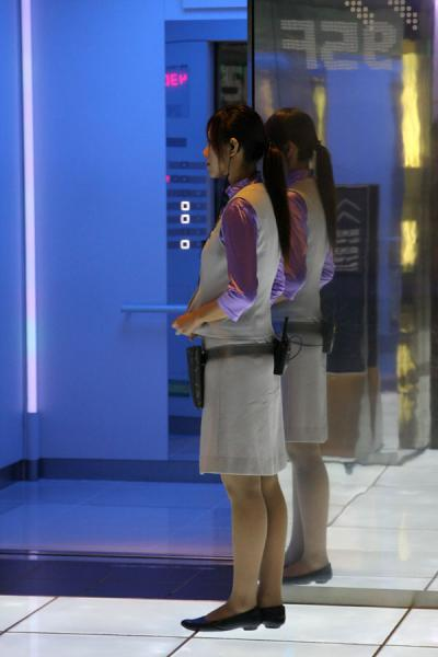 Young Chinese woman working at an elevator in the SWFC | Shanghai World Financial Center | China