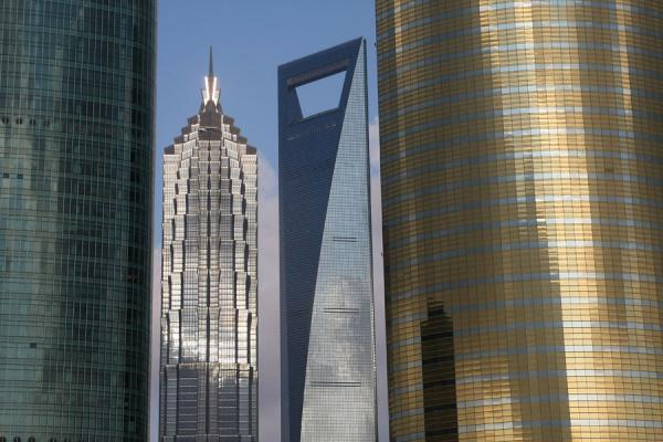 Picture of Shanghai World Financial Center seen between Jin Mao tower and other modern buildings