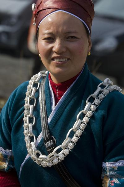 Miao woman with silvery necklaces | Shi Long Zhai | China