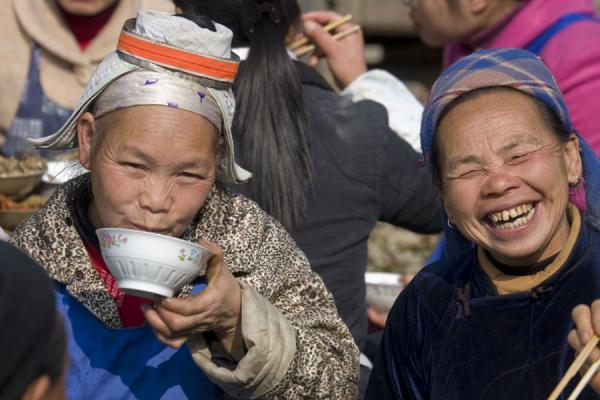 Two old Miao women having lunch | Shi Long Zhai | China
