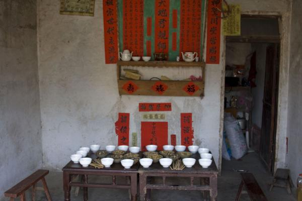 Table with dishes and cups waiting for guests | Shi Long Zhai | China