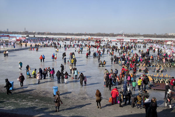 Overview of the frozen Songhua river, full of people engaging in winter fun | Songhua Winter Activities | China