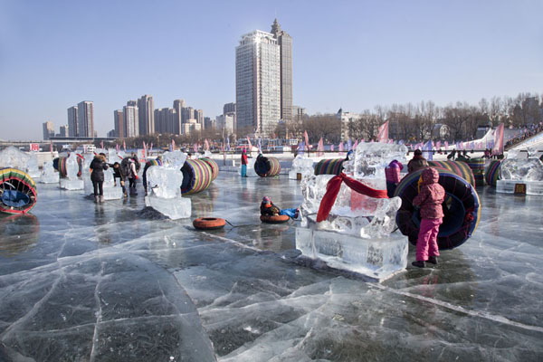 Kids having fun on the thick ice of the Songhua river | Songhua Winter Activities | China