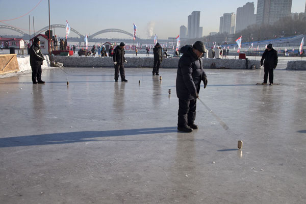Picture of Men with spinning tops on the smooth ice of the Songhua river