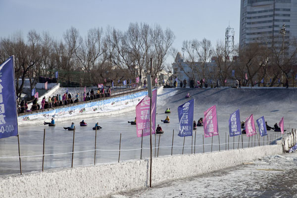 Racing down the icy slopes on the banks of the Songhua river | Songhua Winter Activities | China