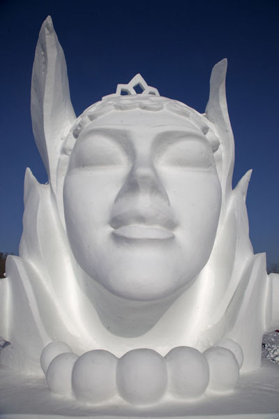 Smooth face of a woman seemingly sunbathing | Snow Sculpture Art Expo | China