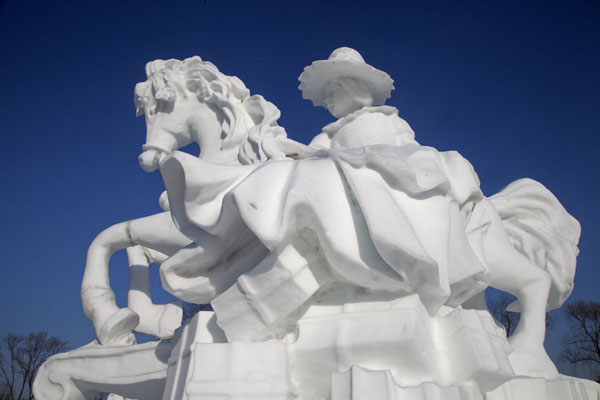 Woman with hat on a horse | Snow Sculpture Art Expo | China