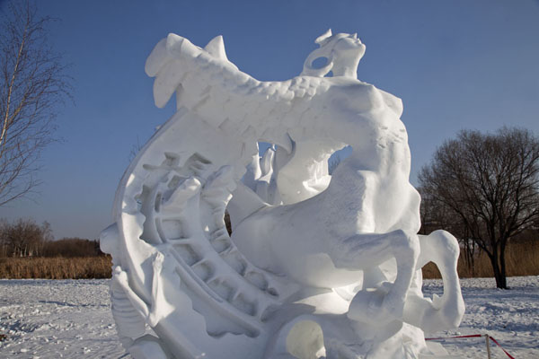 Fantasy sculpture of snow with winged nude female/horse, and a skeleton clinging on | Snow Sculpture Art Expo | China