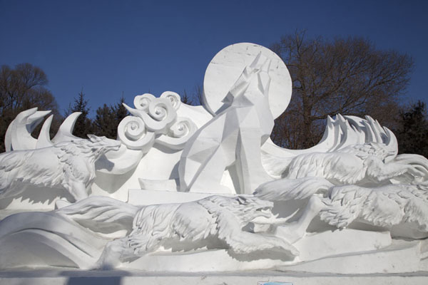 Scene depicting wolves howling at the full moon | Snow Sculpture Art Expo | China