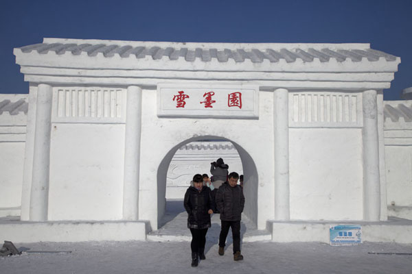 People walking out of a snow temple | Snow Sculpture Art Expo | China