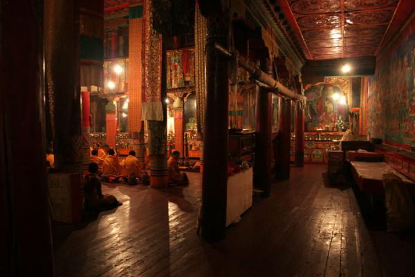 Monks praying inside the Tagong Lamasery | Tagong monastery | China