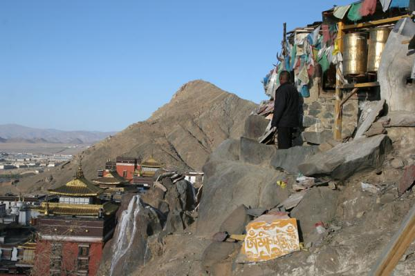 Pilgrim looking over Tashilhunpo monastery and beyond | Tashilhunpo kora | China