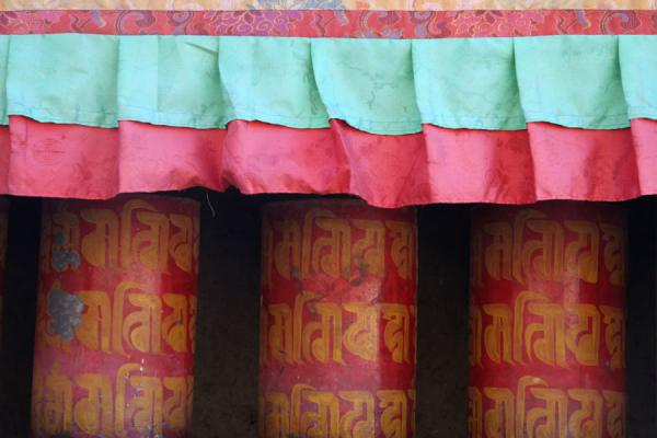 Red and yellow painted prayer wheels on Tashilhunpo kora | Tashilhunpo kora | China