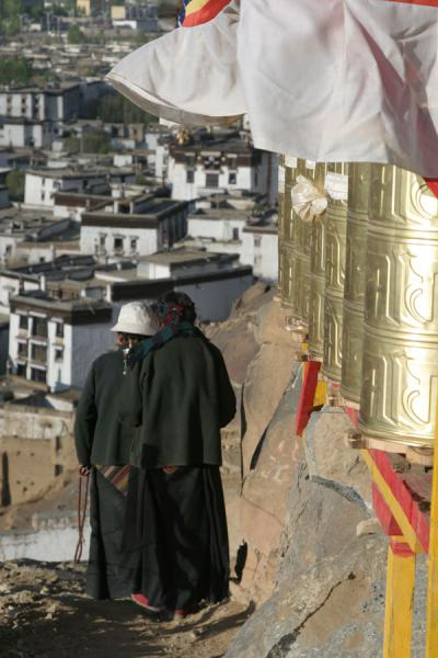 Two female pilgrims walking down the Tashilhunpo kora | Tashilhunpo kora | China