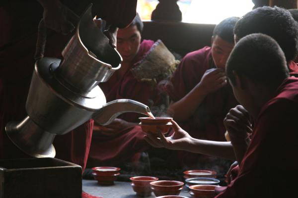 Monks of Tashilhunpo monastery gathering for an afternoon tea | Tashilhunpo monastery | China