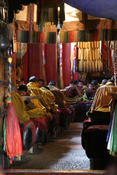 Looking into one of the gathering rooms of Tashilhunpo monastery | Tashilhunpo monastery | China