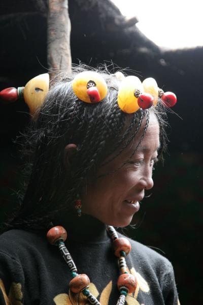 Tibetan nomad woman with traditional jewellery in nomad tent | Tibetan nomads | China