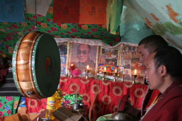 Picture of Tibetan nomads (China): Tibetan monks and altar in side a nomad tent