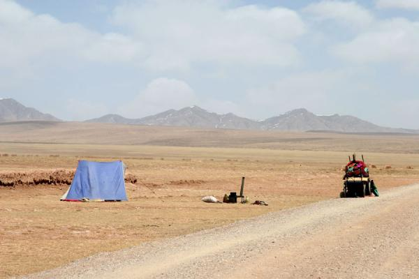 Picture of Tibetan pilgrims (China): Tent, stove and carts belonging to Tibetan pilgrims in an empty Qinghai landscape