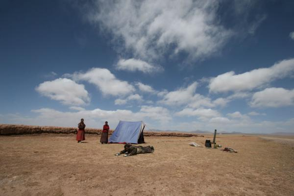 Picture of Tibetan pilgrims (China): Tibetan pilgrim prostrating near his tent