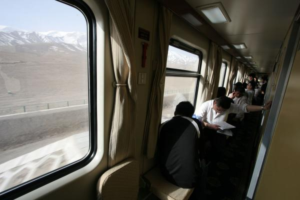 Passengers on the train to Lhasa sitting in the aisle | Train to Lhasa | China