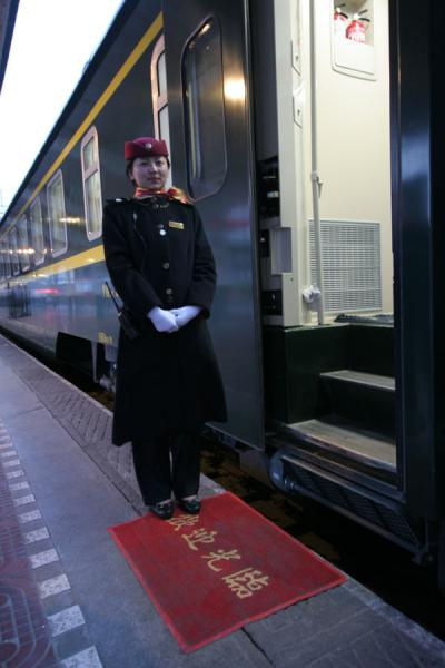 Picture of Train to Lhasa (China): Train hostess waiting for passengers on the train to Lhasa