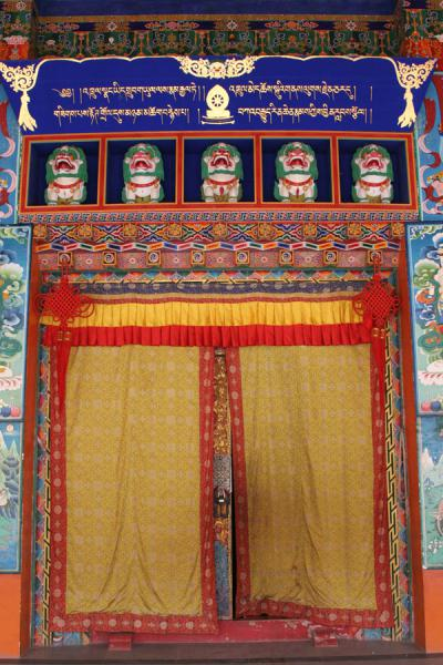 Main entrance door to the general assembly hall of Trangu monastery | Trangu monastery | China