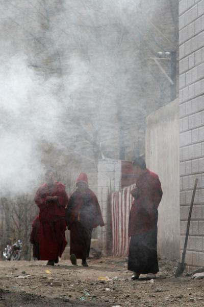 Monks enveloped by smoke at Trangu monastery | Trangu monastery | China