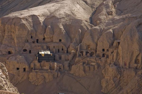 Thousand Buddha Grottoes in the cliff face of the canyon cutting through the Flaming Mountains | Tuyoq Old Town | China