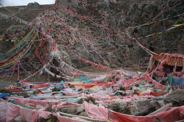 Picture of Wencheng temple (China): Brightly coloured prayer flags above Wencheng temple