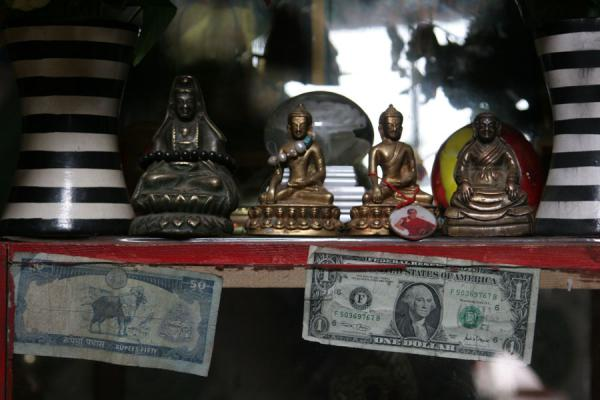 Small statues with money in Wencheng temple | Wencheng temple | China