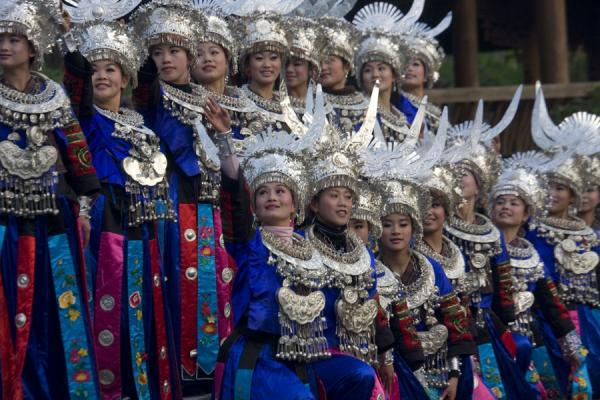 Picture of Traditionally dressed Miao women dancing for visitors
