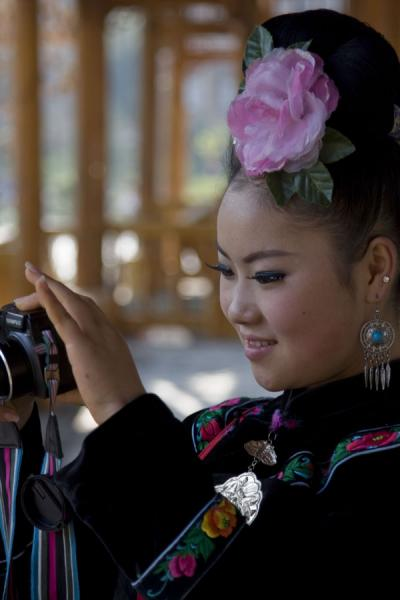 Tourist working her camera in Xijiang village | Xijiang | China
